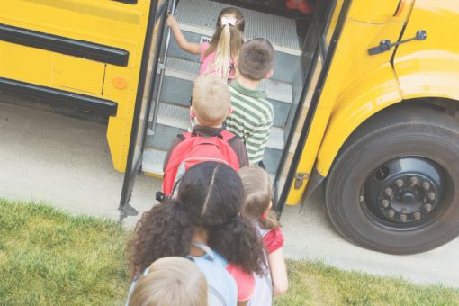 Kids getting on school bus | Future Ready Collier - Naples, Florida