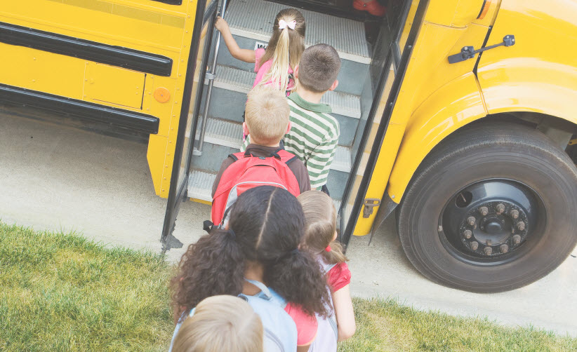 Kids getting on school bus   Future Ready Collier - Naples, Florida