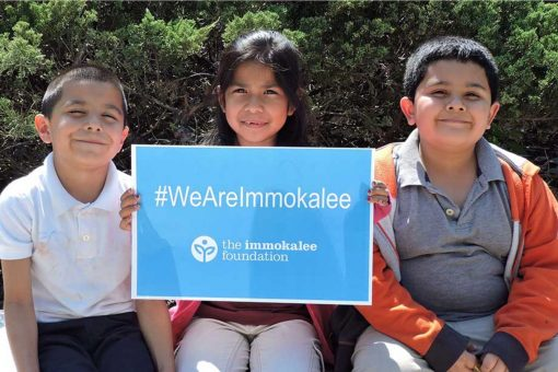 Immokalee Foundation children We Are Immokalee sign