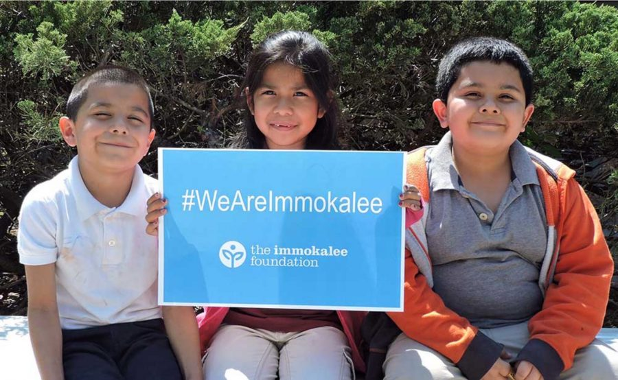 Immokalee Foundation children We Are Immokalee sign