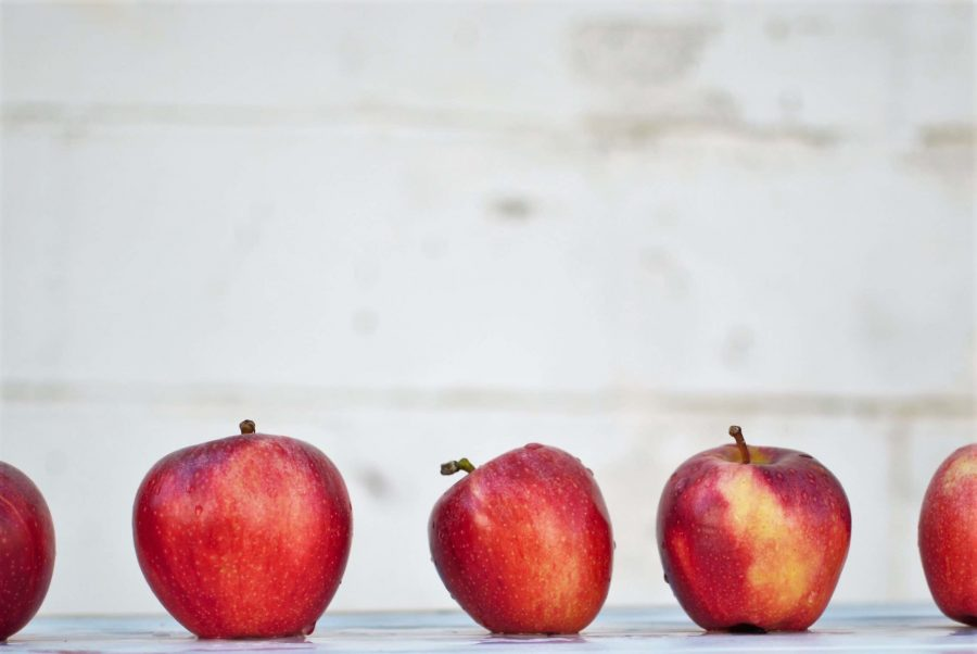 apples in a row on a table