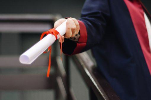 handing diploma